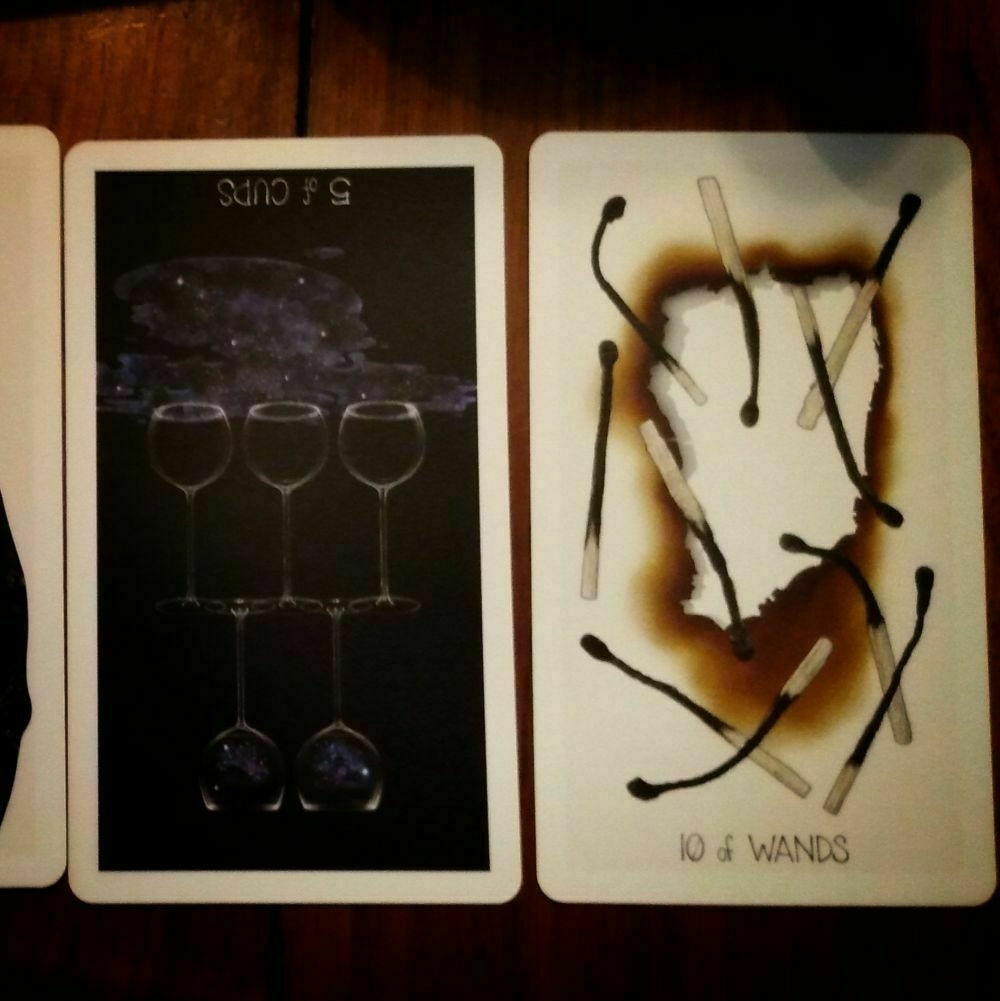 Tarot Cards: 5 of Cups reversed and 10 of Wands